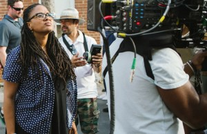Director/Executive Producer Ava DuVernay (center) on the set of SELMA, from Paramount Pictures, Pathé, and Harpo Films.
