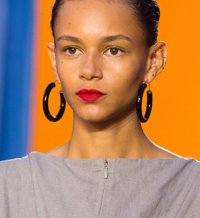 The quintessential French-girl red, Céline's vibrant cherry, worn with an otherwise bare face, echo's last season's makeup look. For a similar shade, try Nars Lipstick in Heat Wave.