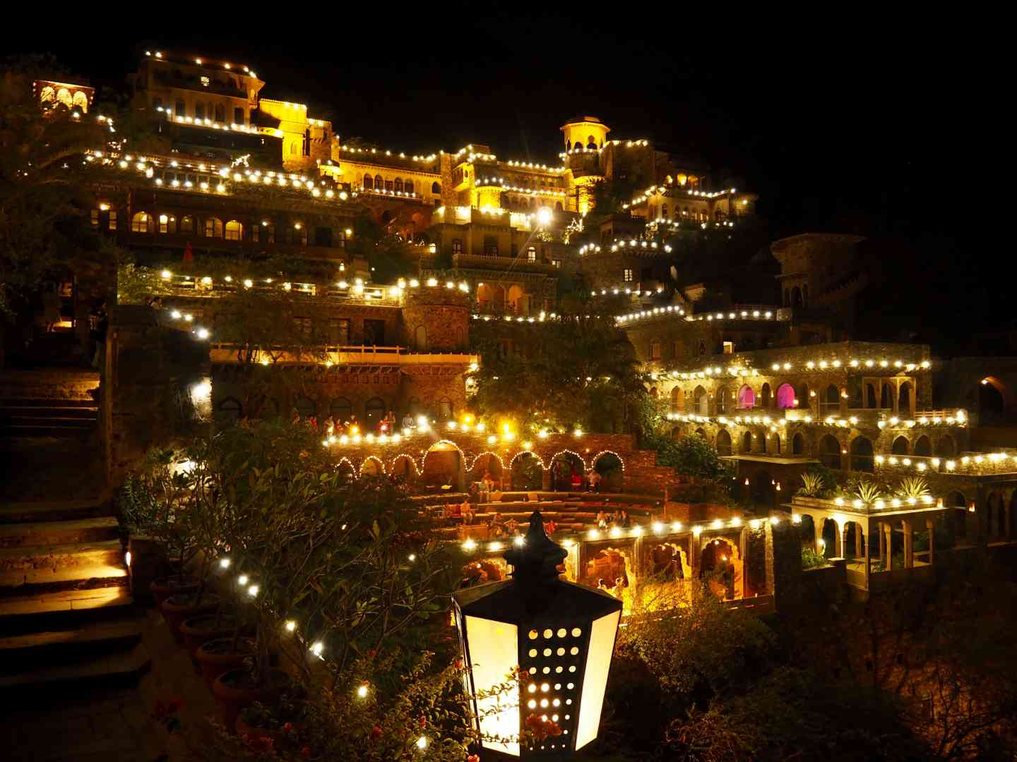 NEEMRANA FORT PALACE AT NIGHT