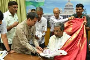 D P Ananth with CM Siddaramaiah