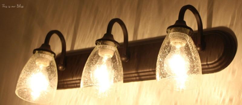 Simple bathroom vanity light fixture update this is our for Updating bathroom light fixtures