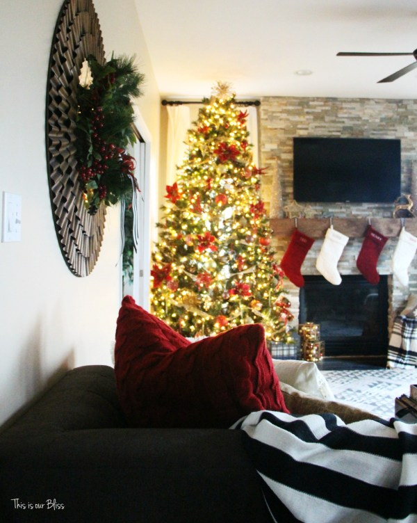 family room tree - 12 days of christmas tour of homes - blogger holiday tour - stockings on mantle - stacked stone fireplace - This is our Bliss