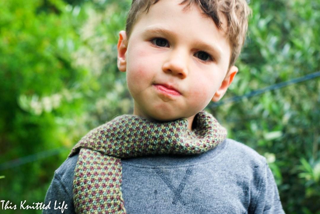 A scrap yarn toddler scarf.