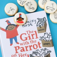 the girl with the parrot on her head + doodle cookies from the decorated cookie