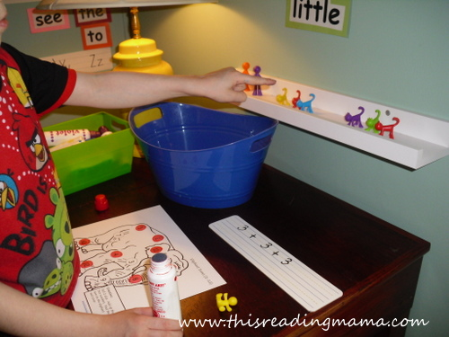 photo of using manipulatives to add and stamp numbers