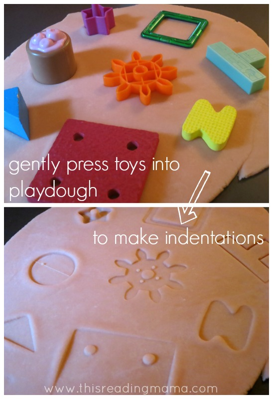 using toys to make indentations in playdough