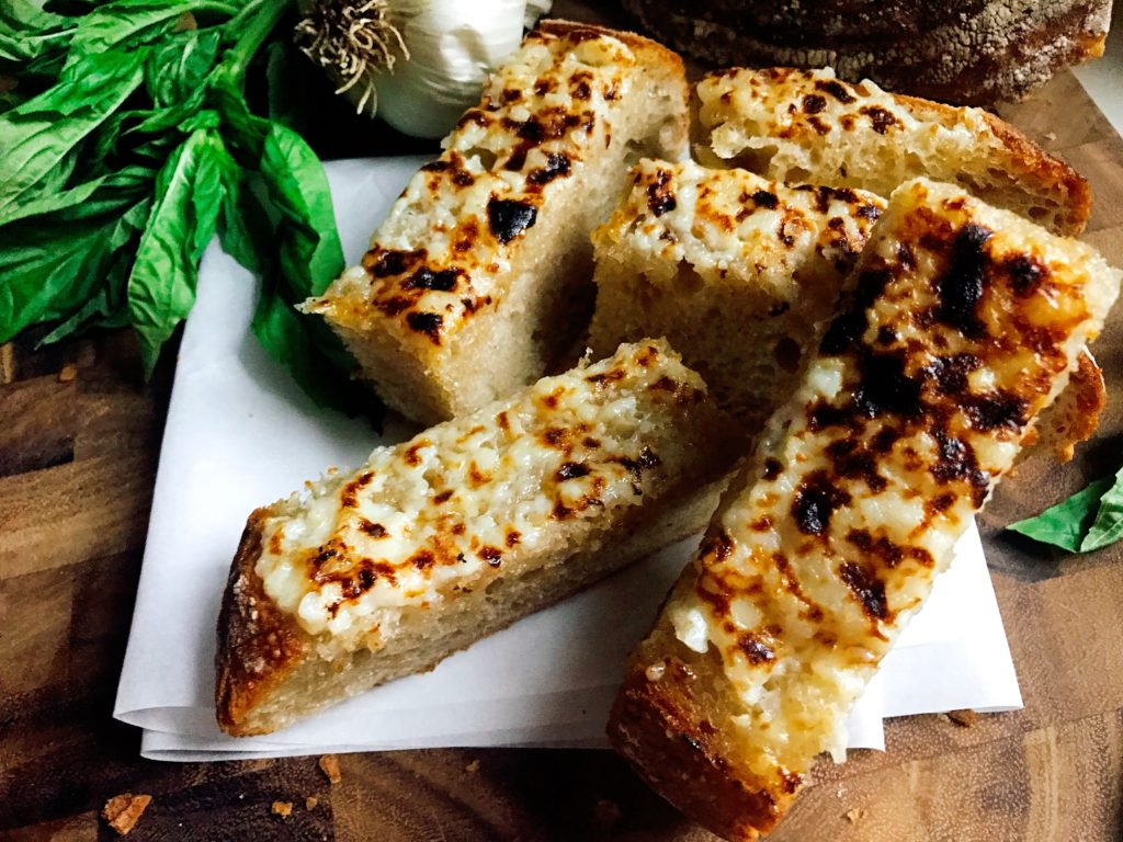 A fast and easy vegetarian side dish for Italian dinners. Ready in less than 10 minutes, this Sourdough Garlic Bread is kid friendly and packed full of flavor.