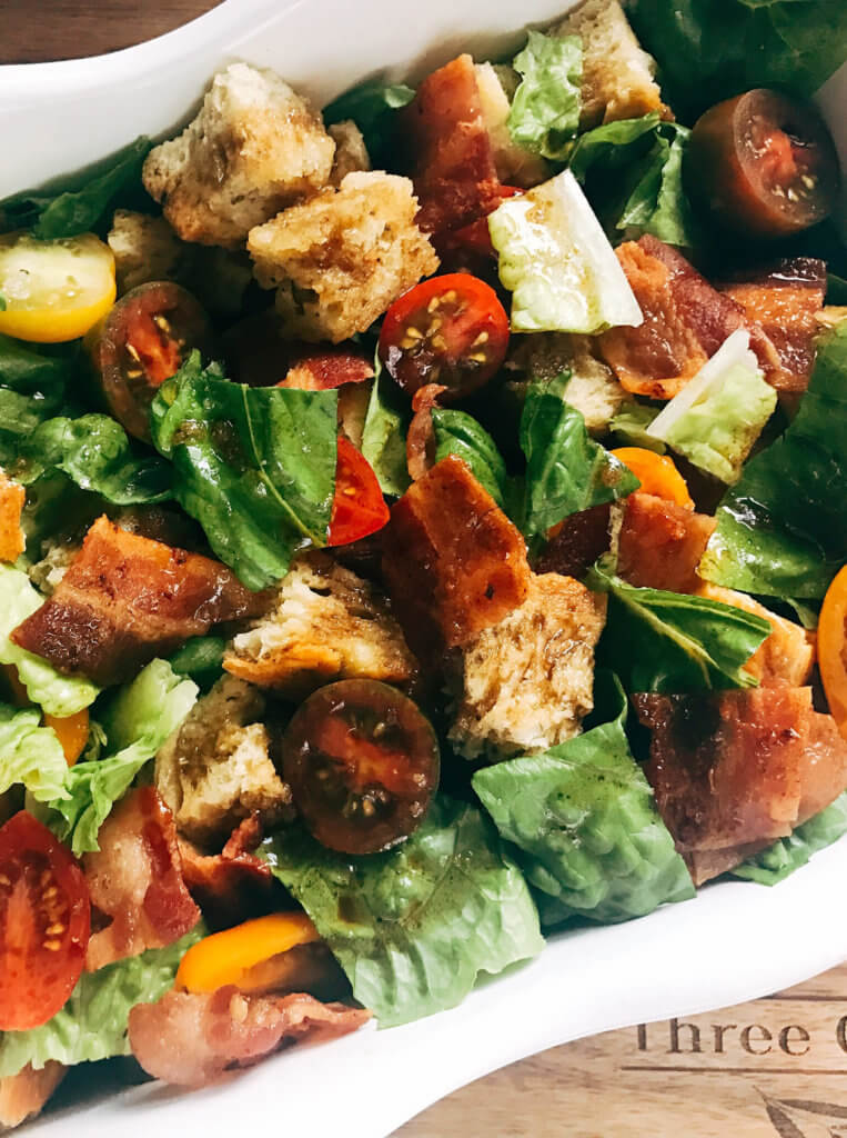 A simple side dish perfect for any BBQ event, grill out, or party like the 4th of July, Father's Day, Memorial Day, or Labor Day. The classic flavors of a BLT sandwich are combined with a classic Italian panzanella salad (bread salad) with a light vinaigrette. Also great with ranch or Caesar dressing. Simple and easy to make, kid friendly, and great for summer grilling. Tomatoes, bacon, lettuce, and bread. BLT Panzanella Salad | Three Olives Branch | www.threeolivesbranch.com