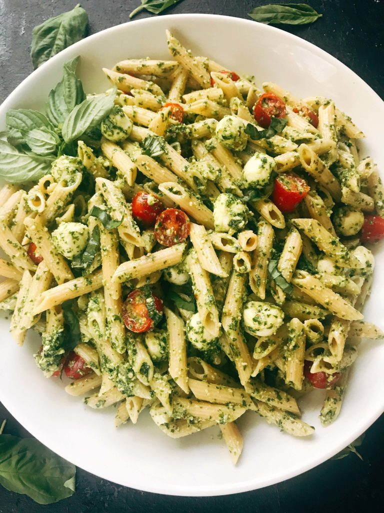 Less than 25 minutes to make this fresh basil pesto pasta with cherry tomatoes and fresh mozzarella cheese. A quick and simple Italian pasta recipe highlighting fresh caprese flavors. Vegetarian recipe but add chicken or sausage for the meat lovers. Featuring Barilla ProteinPLUS pasta, this dinner recipe is nutritious and hearty, packed with protein, fiber, and Omega-3. Pesto Caprese Penne Pasta   Three Olives Branch   www.threeolivesbranch.com