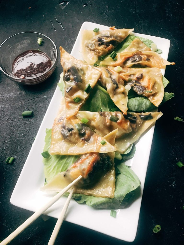 Potstickers made with mushrooms, cabbage, carrots, ginger, green onions, and Mongolian sauce. A fun Asian recipe that is perfect as an appetizer or full meal. Featuring P.F. Chang's Mongolian Home Sauce. Mongolian Potstickers | Three Olives Branch | www.threeolivesbranch.com