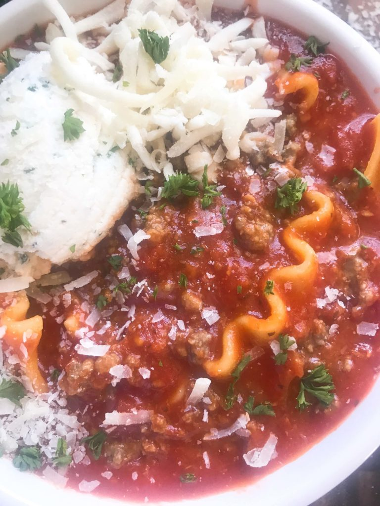 A hearty soup recipe perfect for your crock pot on busy and cold nights. Simple and easy to prepare, this soup is topped with herbed ricotta cheese for classic Italian comfort food in a bowl. Slow Cooker Beef Lasagna Soup | Three Olives Branch | www.threeolivesbranch.com #italianfood #slowcookersoup #lasagna
