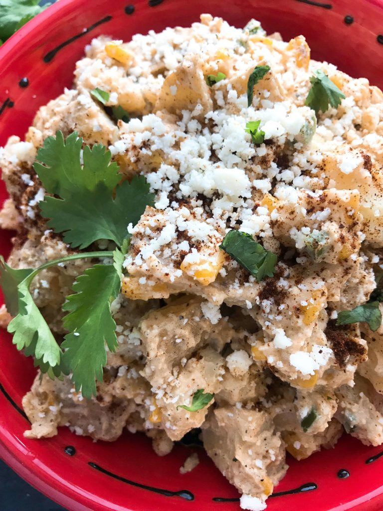 A unique twist on a classic side dish recipe, this potato salad is perfect for a summer BBQ or grilling party. Flavors of elote (corn, chili powder, lime, jalapeno, cotija cheese) highlight this cold side dish. Easy to make in advance. Vegetarian and gluten free. Mexican Street Corn Potato Salad | Three Olives Branch | www.threeolivesbranch.com #memorialday #4thofjuly