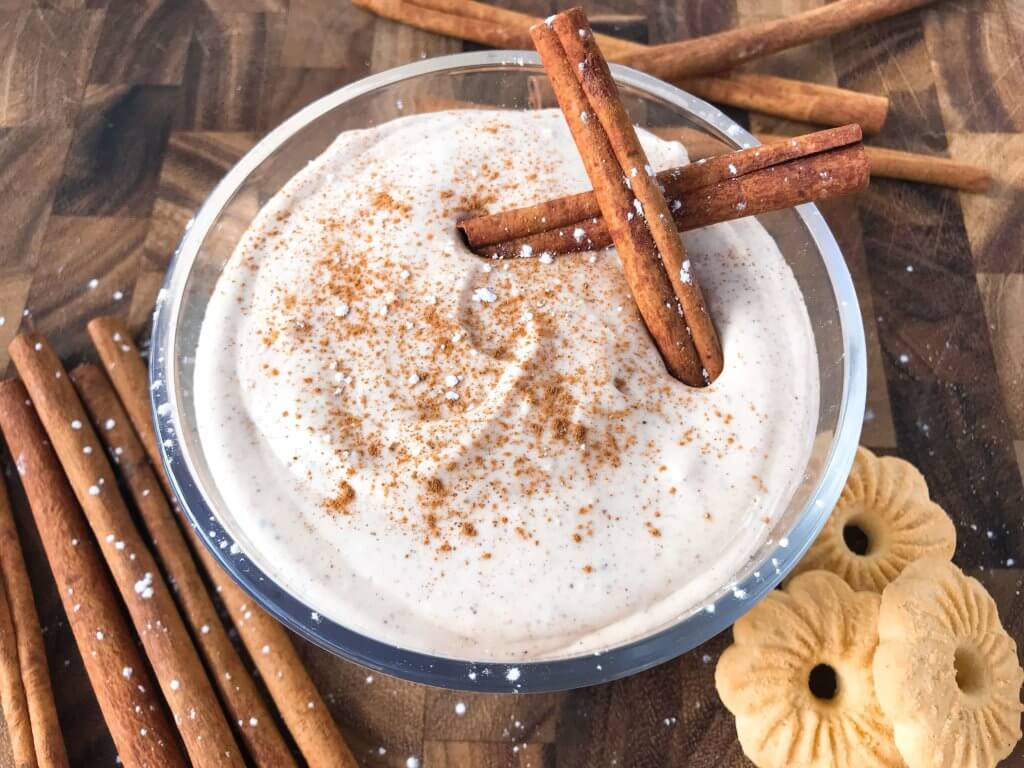 Ready in 5 minutes, this fast and easy holiday dessert is perfect for dunking Christmas cookies. Eggnog Cream Cheese Dip is made with cream cheese, sugar, eggnog, cinnamon, and nutmeg for a simple Christmas dessert. Vegetarian and gluten free. #christmasdessert #eggnog #christmasrecipe