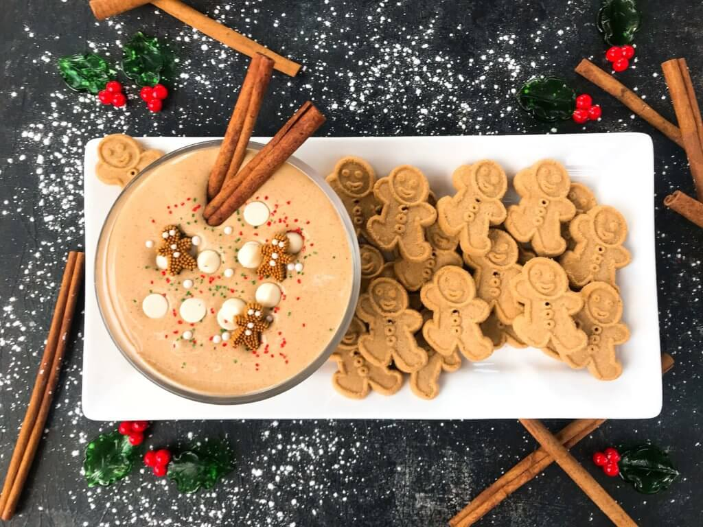 This fast and easy holiday Christmas dessert recipe is ready in 5 minutes. Gingerbread Cream Cheese Dip is gluten free, vegetarian, and flavored with cinnamon, molasses, nutmeg, and ginger. Dunk gingerbread cookies, apples, and pears. #christmasrecipe #holidaydessert #christmasdessert