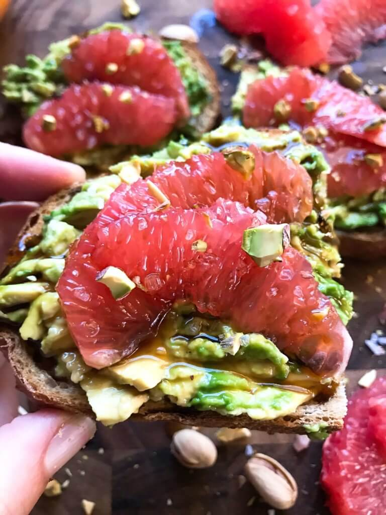 A quick and simple vegan breakfast or brunch recipe ready in just a few minutes. Balsamic Grapefruit Avocado Toast sprinkled with chopped pistachios. #avocadotoast #breakfastrecipes #veganbreakfast