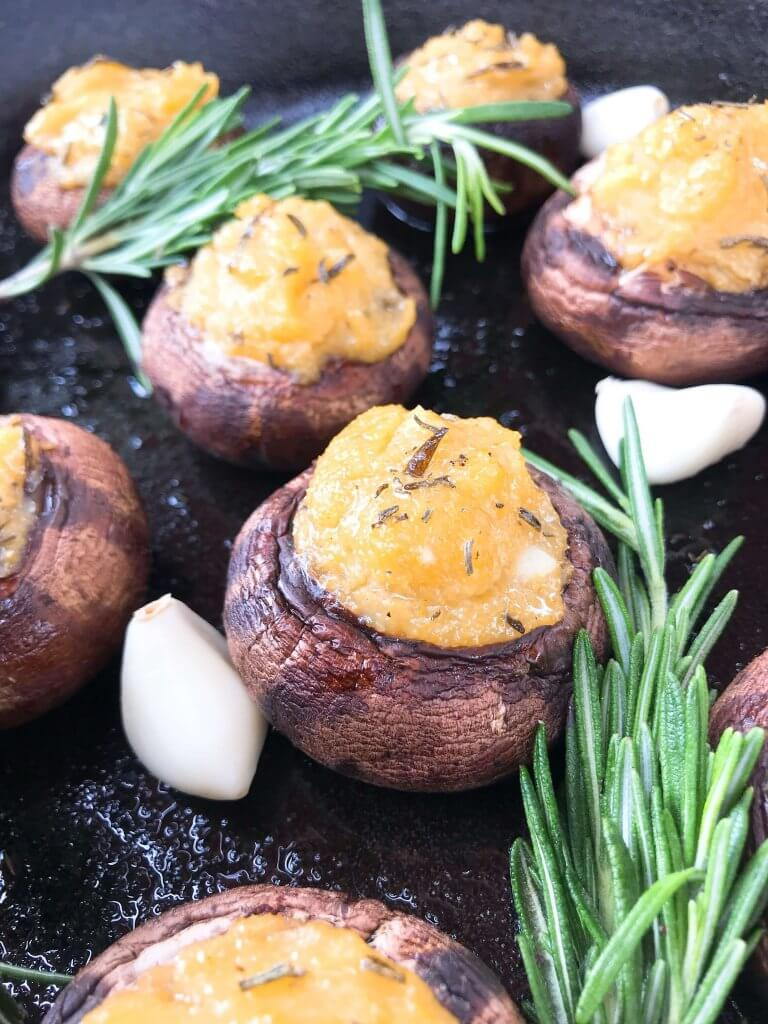 These Garlic Rosemary Polenta Stuffed Mushrooms are a simple and easy appetizer for a party or entertaining. A vegan, vegetarian, gluten free, and dairy free recipe. Leftover cornmeal polenta is a perfect filler. #stuffedmushrooms #partyappetizer #polenta