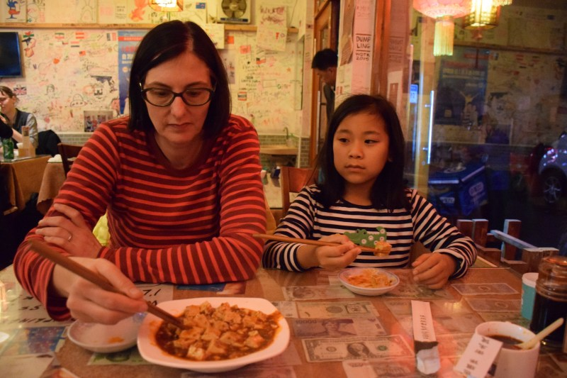 Li Li and Catherine digging into Ma Po Do Fu - quite good with a robust salty flavor.