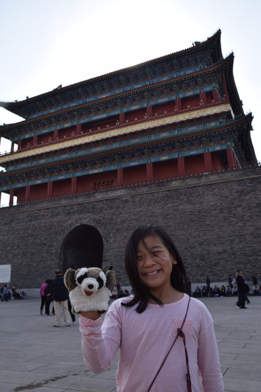 Li Li and Rocky (the class raccoon) outside of the Forbidden City.
