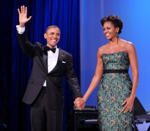 WASHINGTON, DC - SEPTEMBER 14: (AFP-OUT) U.S. President Barack Obama (L) and First Lady Michelle Obama wave during the Congressional Hispanic Caucus Institute's 34th Annual Awards Gala at the Washington Convention Center on September 14, 2011 in Washington, DC. Obama spoke about the $447 billion package of tax cuts as well as public spending and new jobs plan. (Photo by Olivier Douliery-Pool/Getty Images)