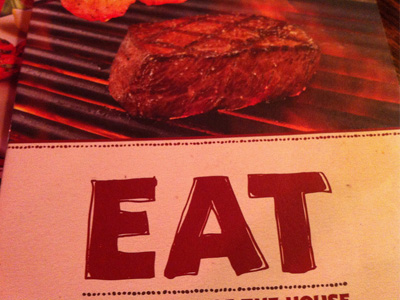 A steak with the word 'Eat' below it.