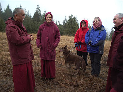Venerable Thubten Chodron, Lama Zopa with retreatants standing and talking.