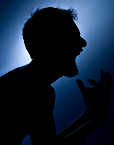A man shouting angrily