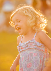 A young girl laughing in happiness.