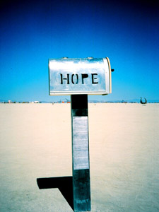 A letterbox with the word HOPE, very clear blue sky in the background.
