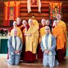 Group of monastics and the two anagarikas, standing with Venerable Chodron.