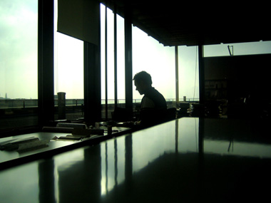 A man working in office facing the window