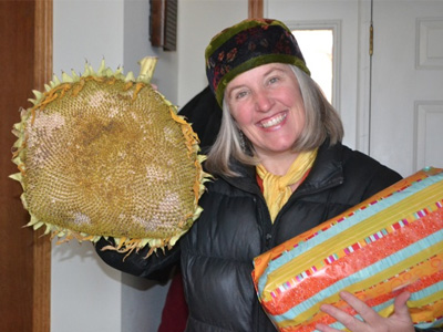 Julia holding a big sunflower she brought as an offer to the Abbey.