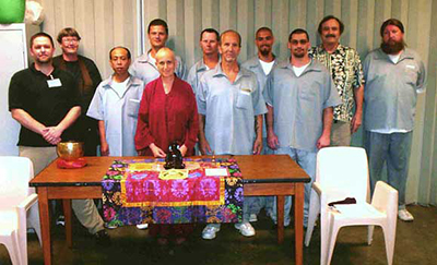 Venerable Chodron standing with inmates at SCCC prison in Licking, Missouri.