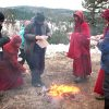 Abbey monastics and guests throwing sesame seeds into fire.