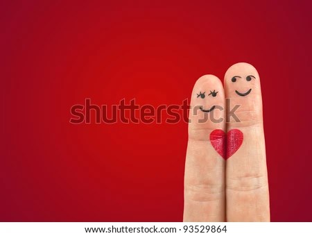 A happy couple in love with painted smiley - stock photo