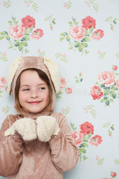 Cute Girl In Bunny Costume Against Wallpaper Stock Photo ...