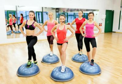 Group Of Female Doing Aerobics With Half Ball Stock Photo ...
