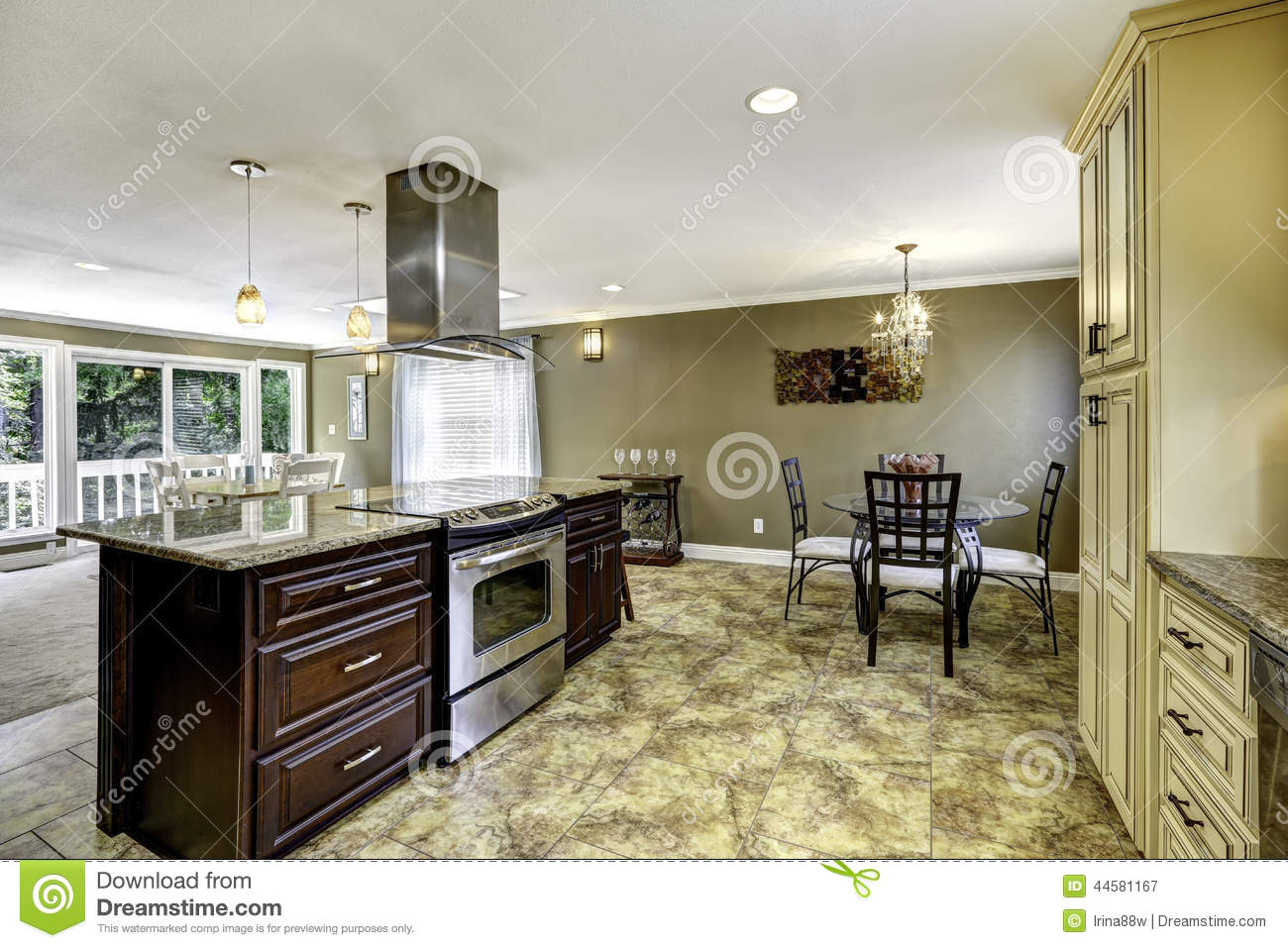 beautiful kitchen island granite top hood spacious room tile floor big built stove steel 44581167