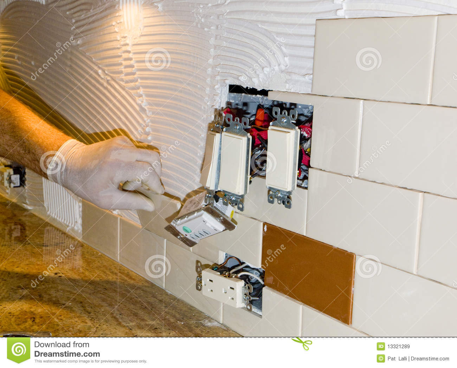 royalty free stock images ceramic tile installation kitchen backsplash 10 image installing kitchen backsplash Ceramic tile installation on kitchen backsplash 10