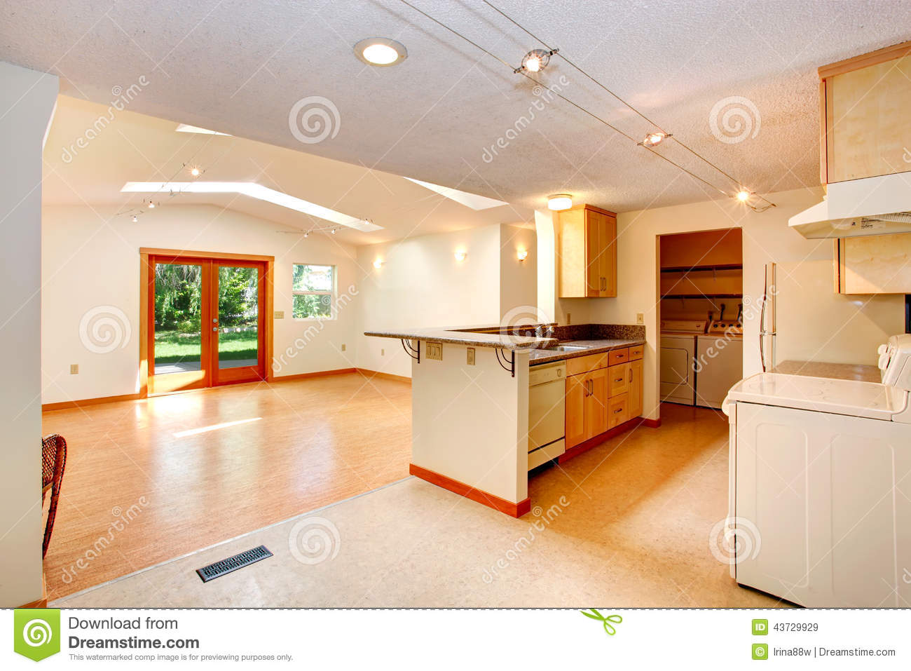 empty house interior open floor plan living room kitch vaulted ceiling skylights view kitchen area 43729929