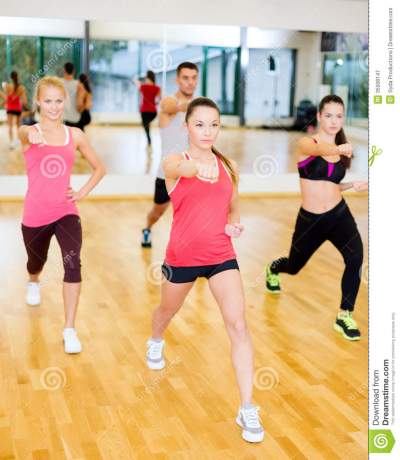 Group Of Concentrated People Exercising In The Gym Royalty ...