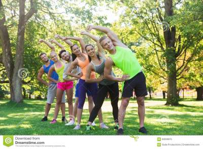 Group Of Friends Or Sportsmen Exercising Outdoors Stock ...