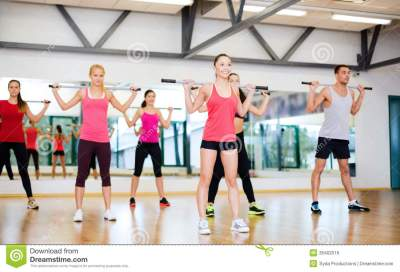 Group Of Smiling People Working Out With Barbells Stock ...