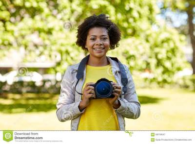 Happy African Woman With Digital Camera In Park Stock ...