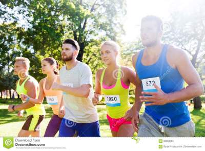 Happy Young Sportsmen Racing Wit Badge Numbers Stock Image ...
