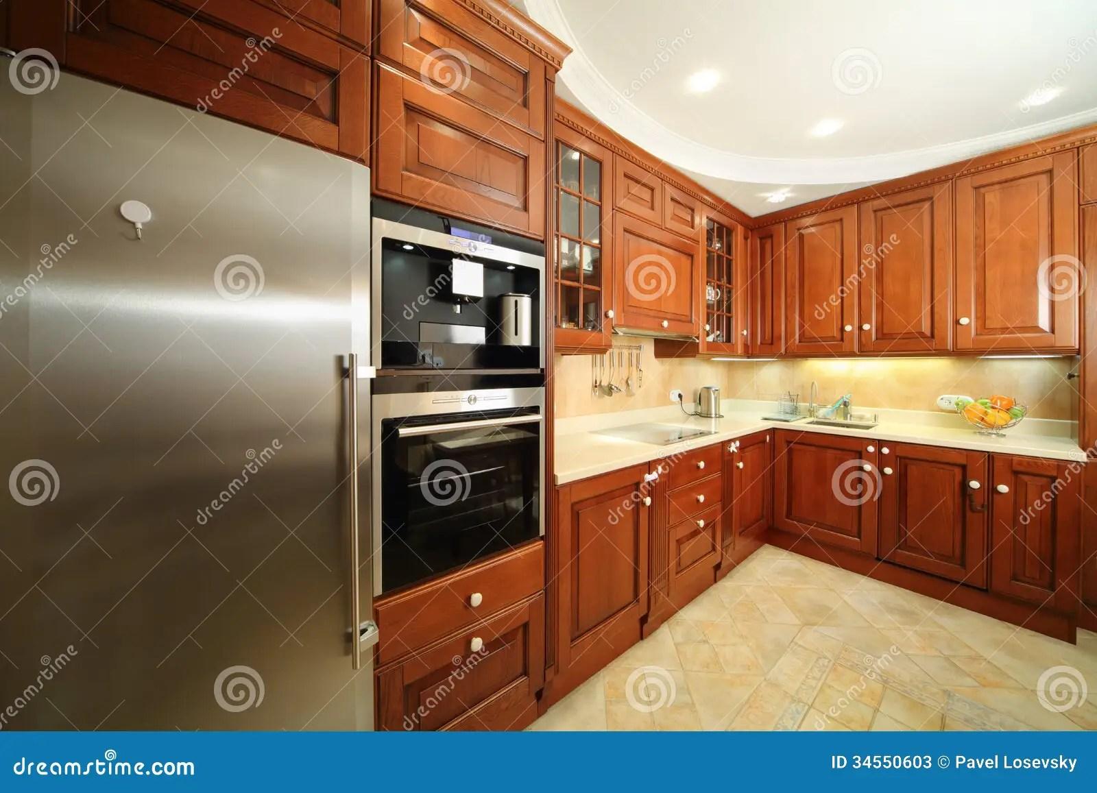 stock photos light clean kitchen wooden furniture integrated oven fridge image kitchen wooden chairs Light clean kitchen with wooden furniture