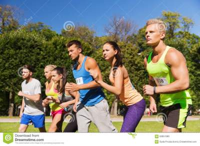 Sportsmen With Badge Numbers On Start Of Race Stock Photo ...
