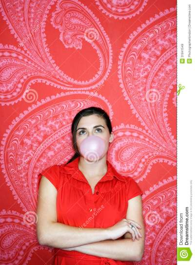 Teenage Girl Blowing Bubble Against Wallpaper Royalty Free Stock Images - Image: 31841549