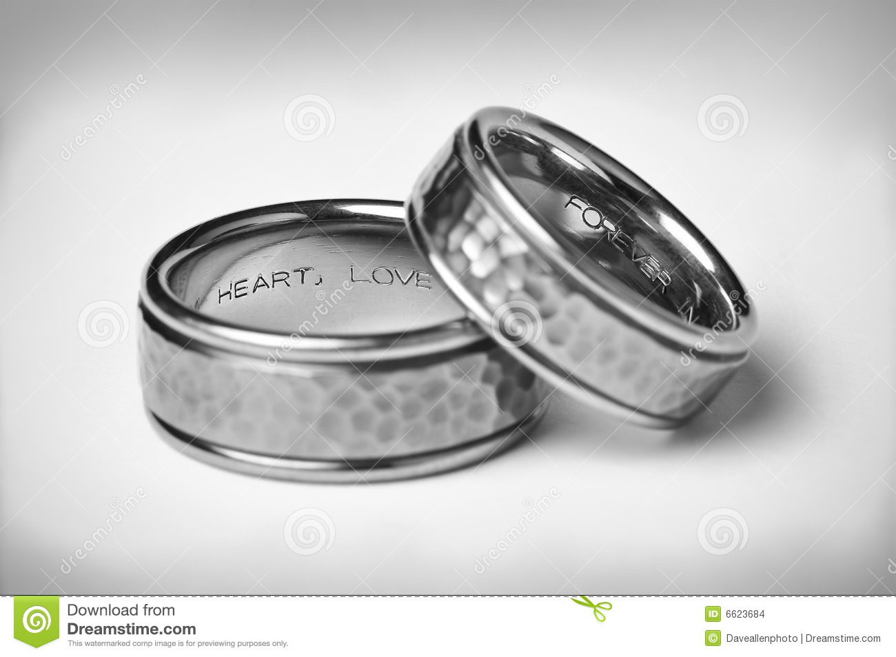stock images two titanium silver wedding bands white image silver wedding ring Two Titanium Silver Wedding Bands On White