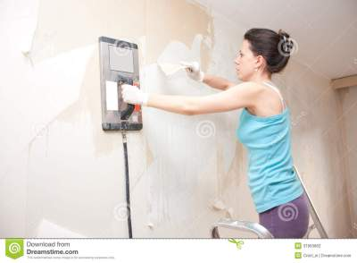 Young Woman Removing Wallpaper Stock Photography - Image ...
