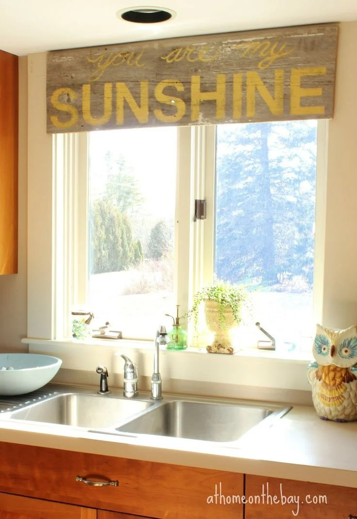 dressing kitchen window kitchen window ideas via Mary at At Home on the Bay